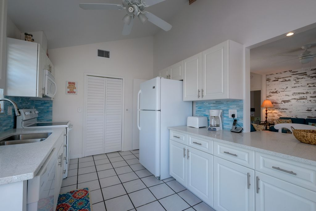 Kitchen with Cafe Doors to Laundry Room
