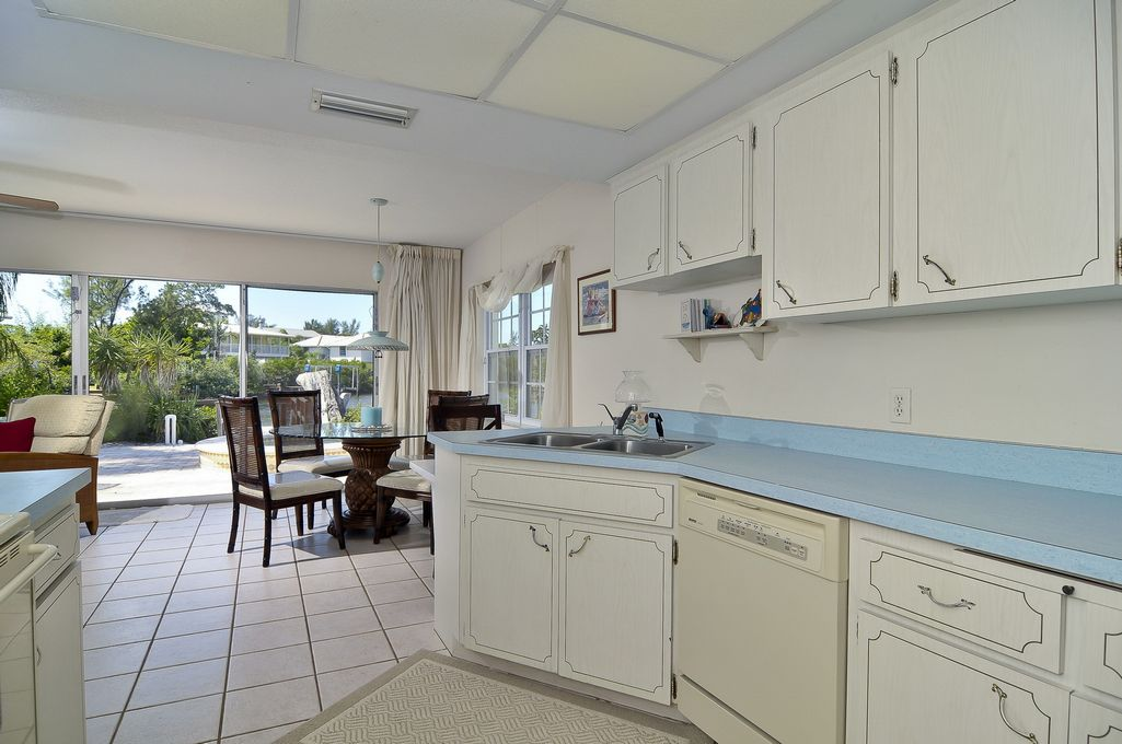 Kitchen and Dining Areas Overlooking Pool & Water