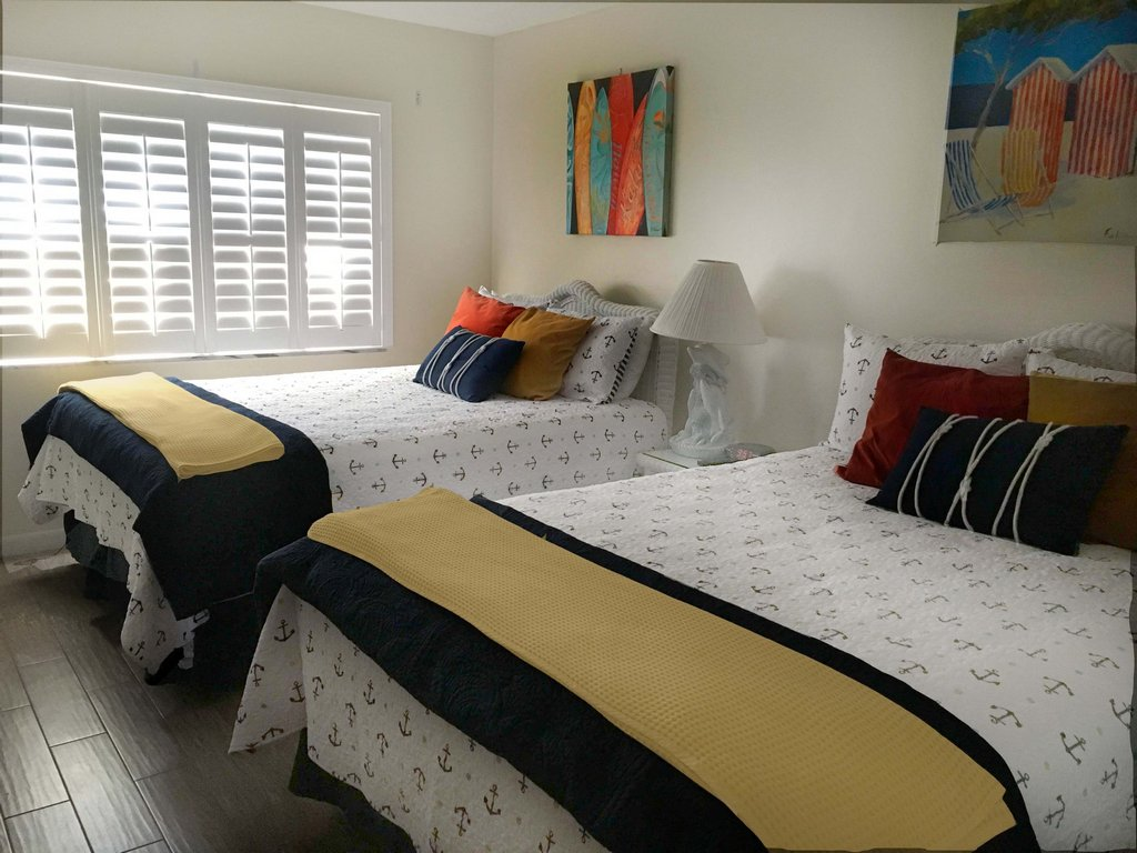 Two Full Sized Beds in the Second Bedroom
