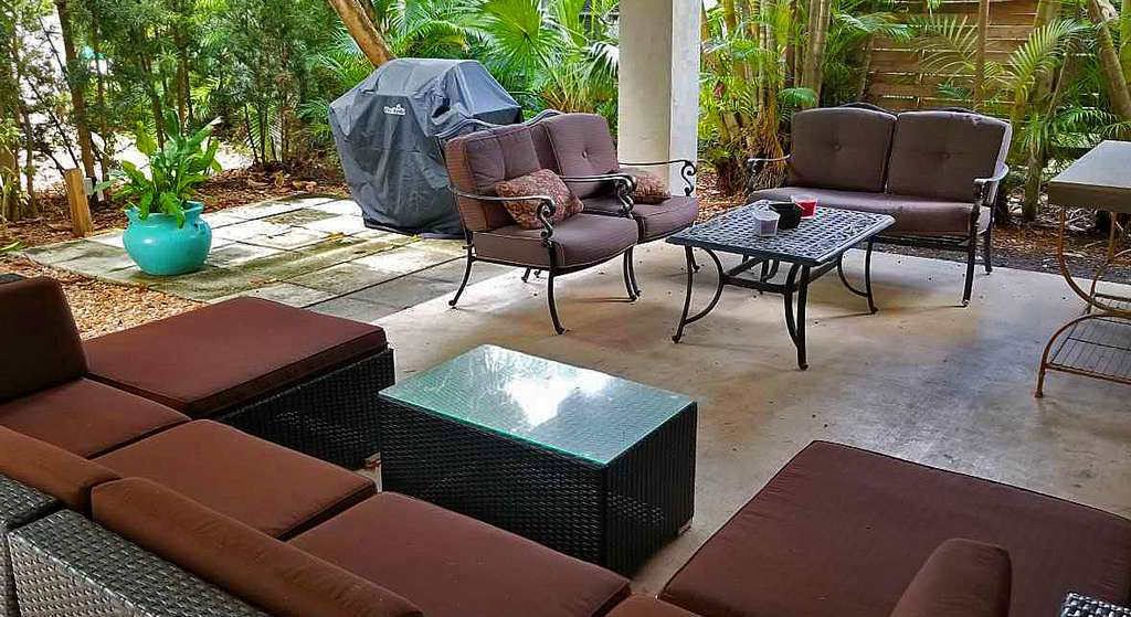 Secluded Lounging Area with Grill on Ground Level