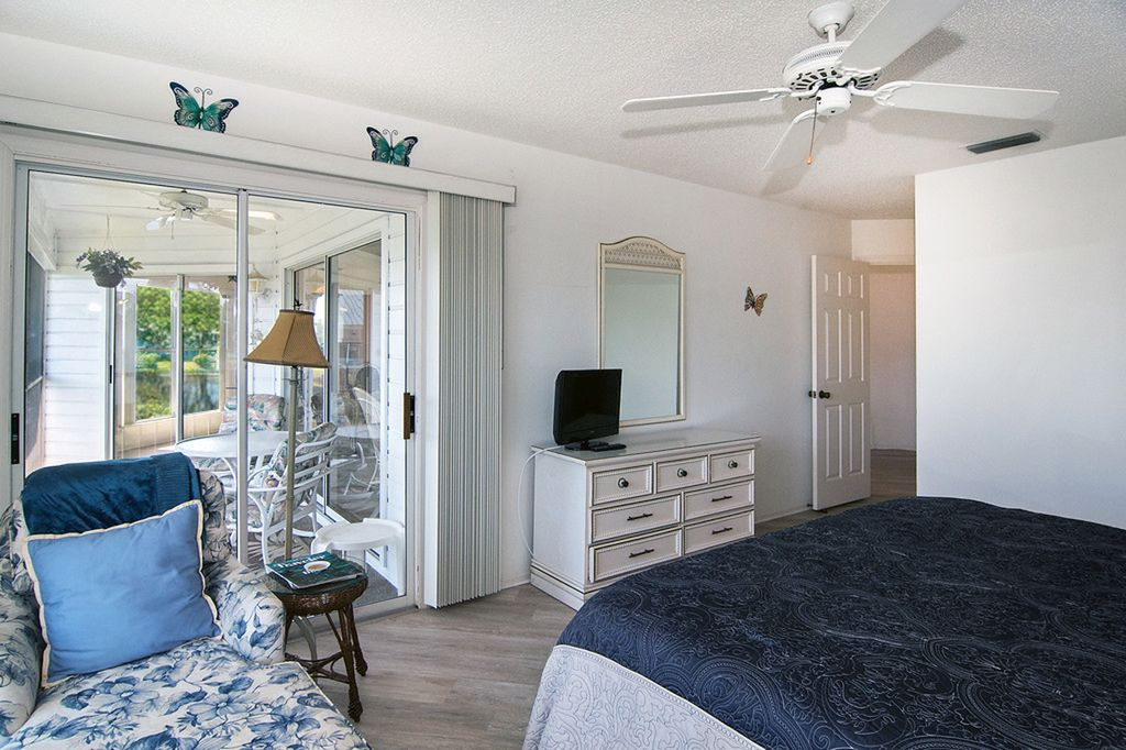 Master Bedroom with Lanai and Water View.