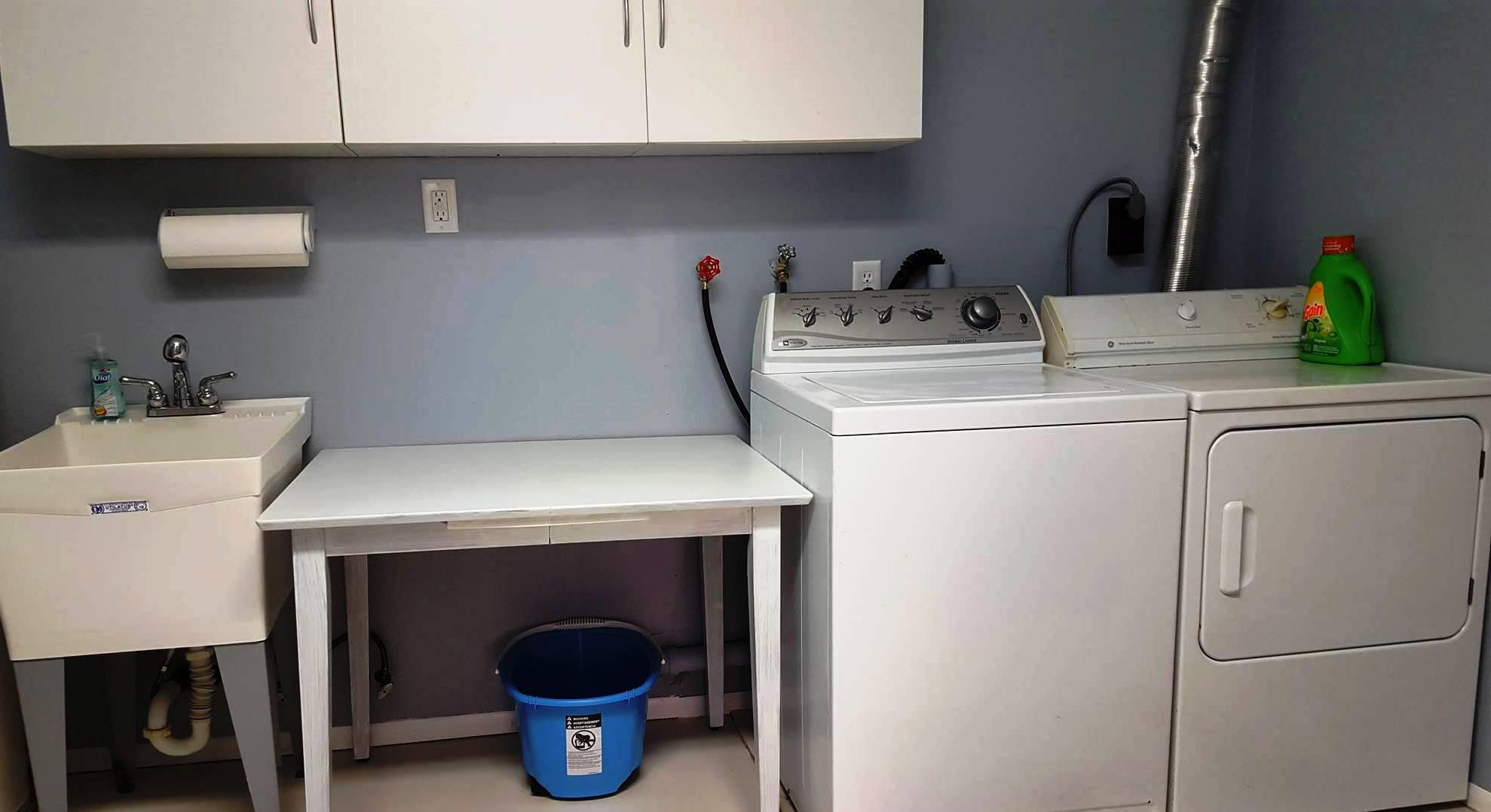 Laundry Room With Sink and Extra Refrigerator