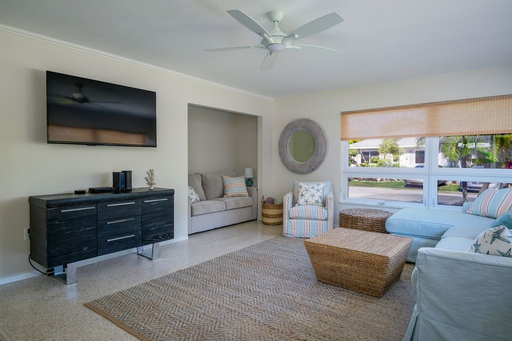 Relax in the Spacious Living Room With Large Flat Screen TV.