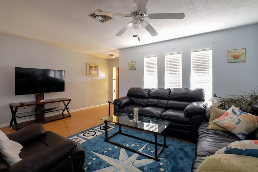 Living Room Has Comfortable Seating and Flat Screened TV