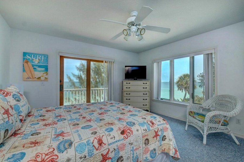 Cheery Guest Bedroom with Beach View and Balcony