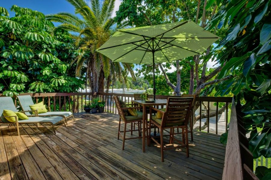 Deck with Tropical Surroundings and Shaded Comfort.