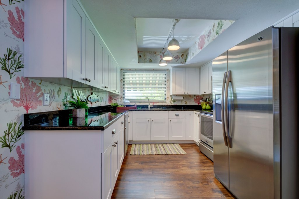 Galley Kitchen with Coastal Vibe.