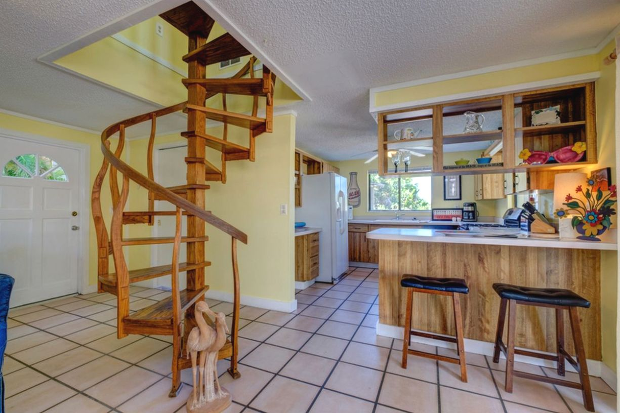 Kitchen with Snack Bar and Spiral Stair to Upper Level