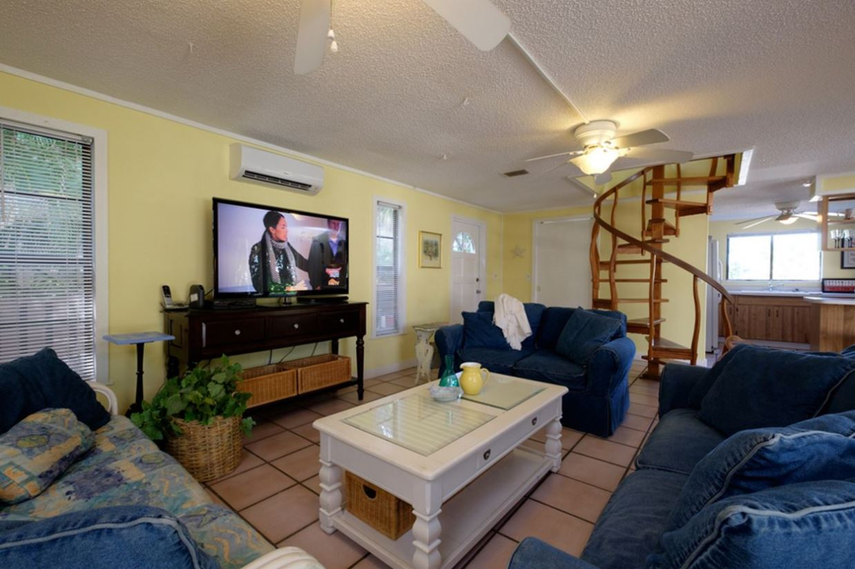 Spacious Living Room with Large Flat-Screened TV