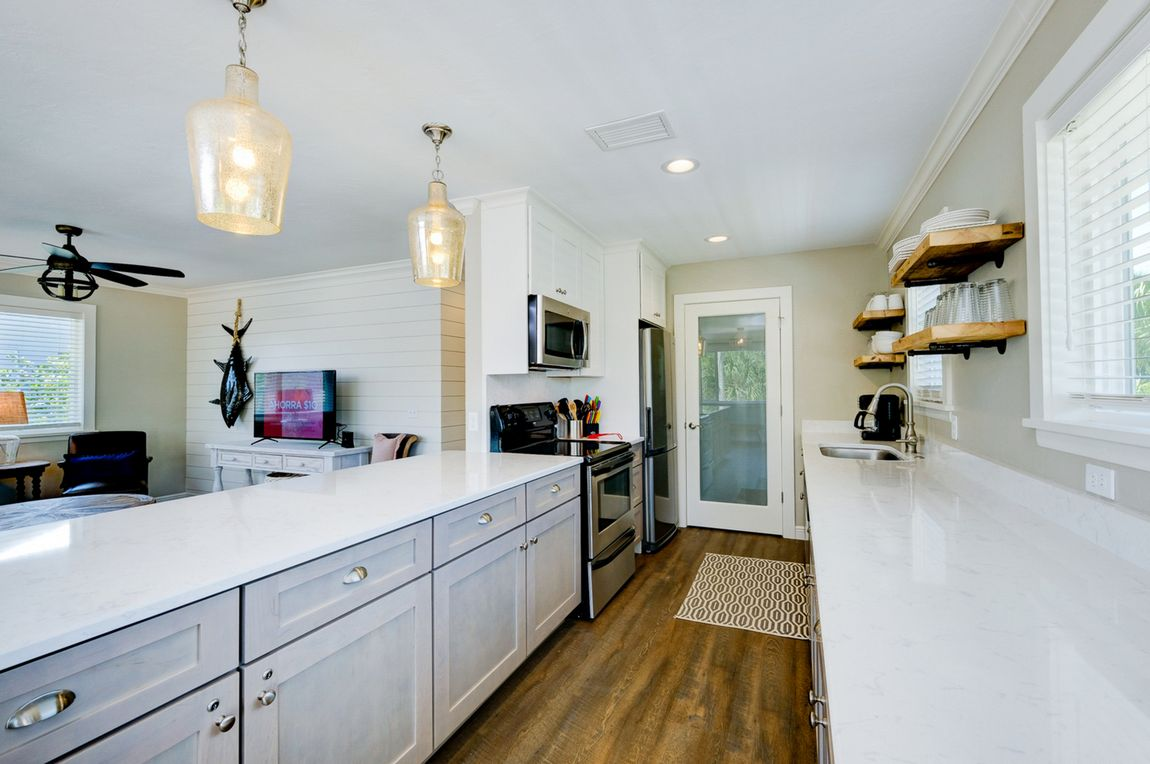 Galley Kitchen Opens into Living Area