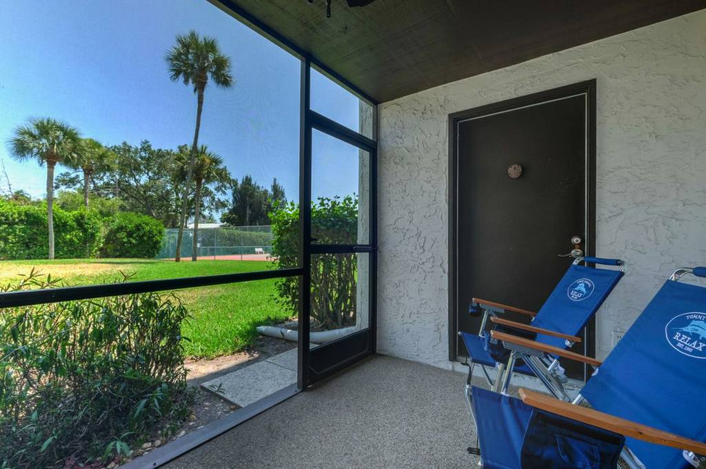 Screened-In Lanai with Walk Out to Tennis Courts and Bay