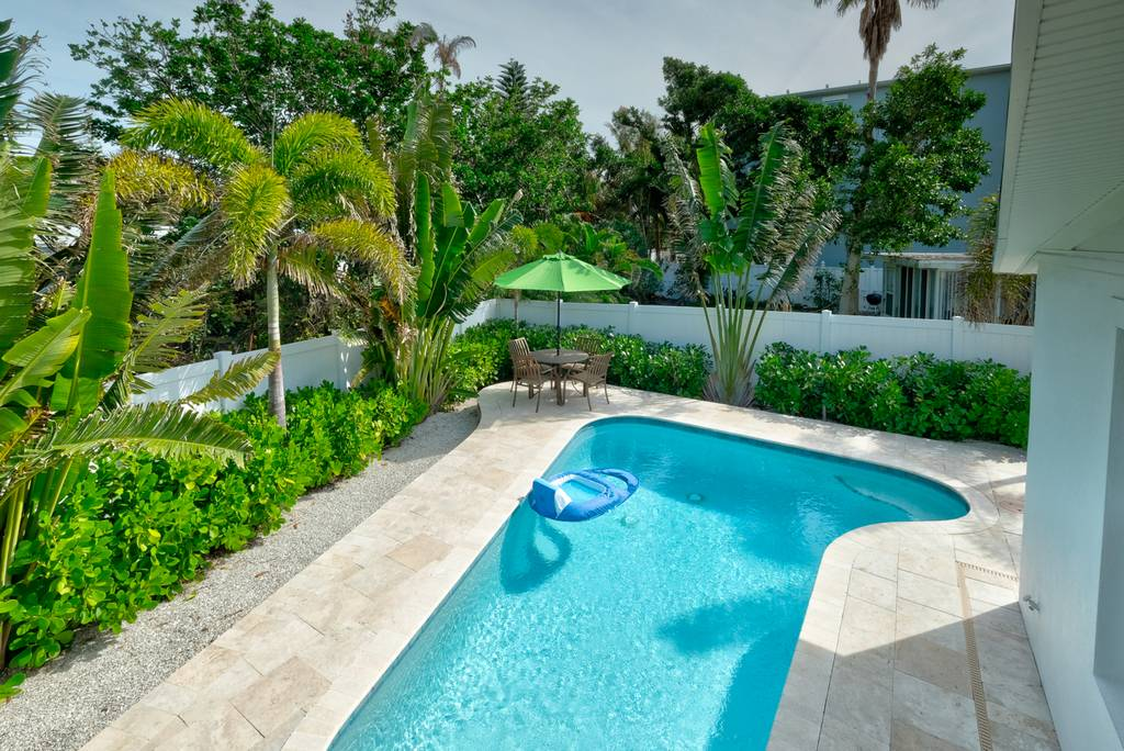 Tropical Landscaping Around The Pool Oasis