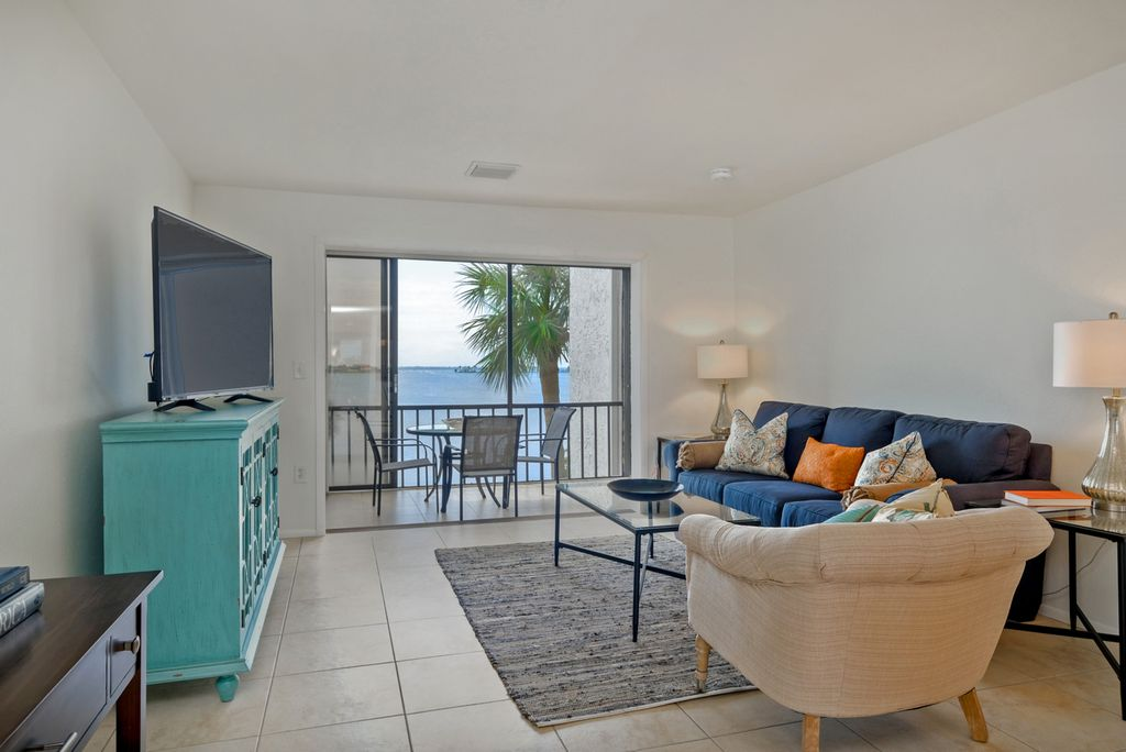 Coastal Living Room with Water View and Balcony