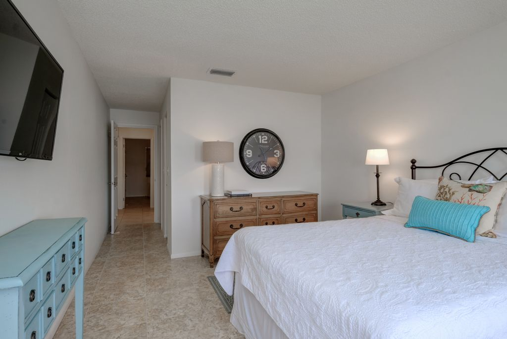 Sleep Soundly with Queen Bed and Mounted TV