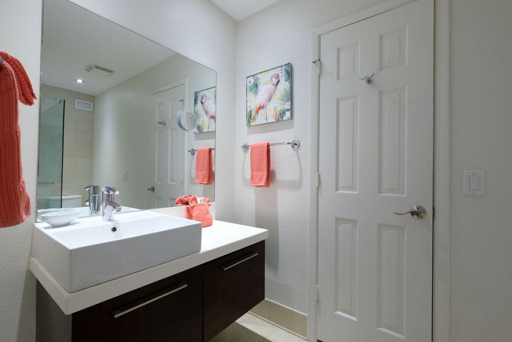 Ensuite Bath with Walk-In Closets