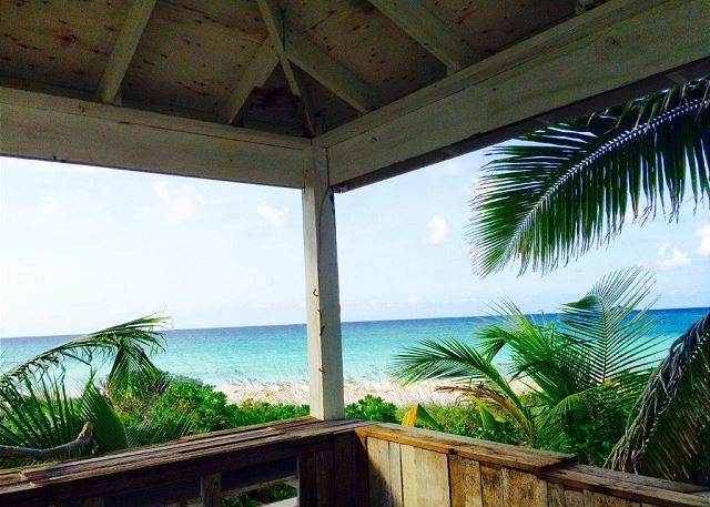 View of ocean and beach from covered veranda