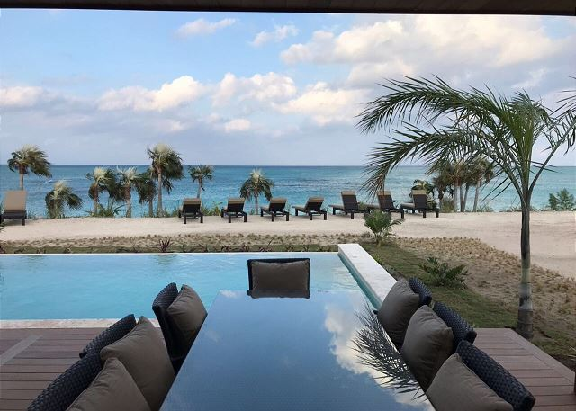 View from covered patio overlooking pool and ocean views