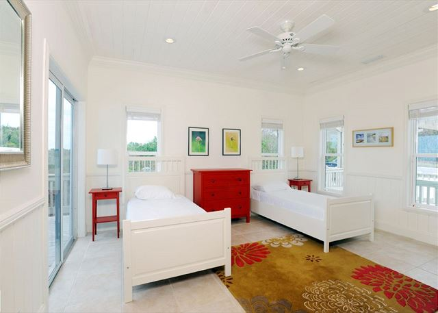 Guest bedroom with twin beds and ocean view