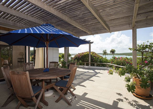 Trellised covered patio with dining area