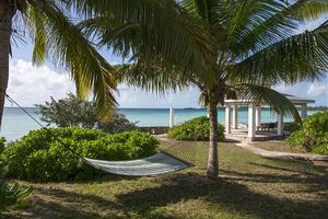 Oceanfront Gazebo with hammock and chairs