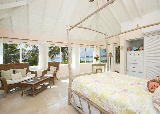 Master bedroom with a wall of ocean views
