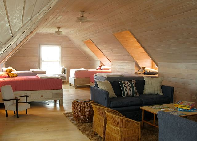 Large finished attic has 4 Single Beds with Living Area and en suite bathroom.