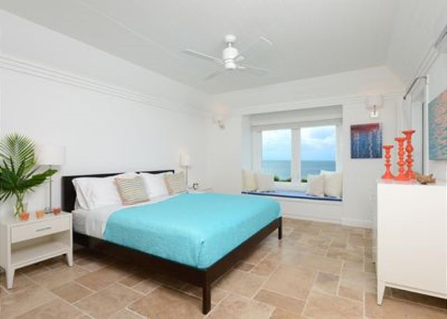 Master suite with balcony, window seat, and 50-mile ocean view.