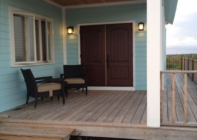 Front porch seating to enjoy the cool island breeze and evening sunsets