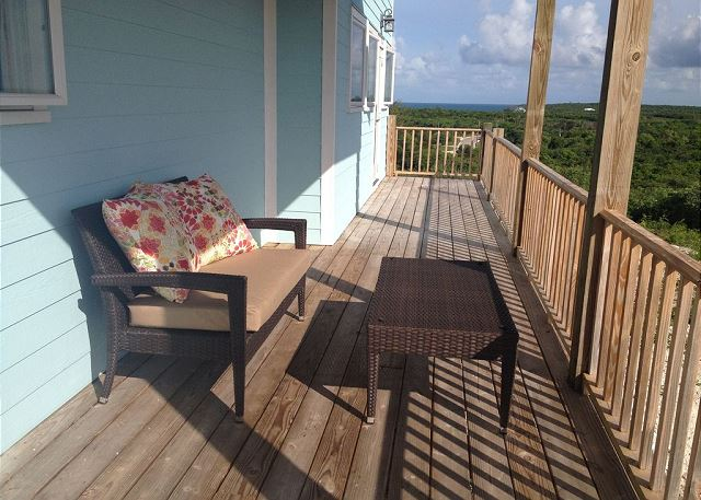 Have your morning coffee or enjoy a book on the back porch with beautiful views