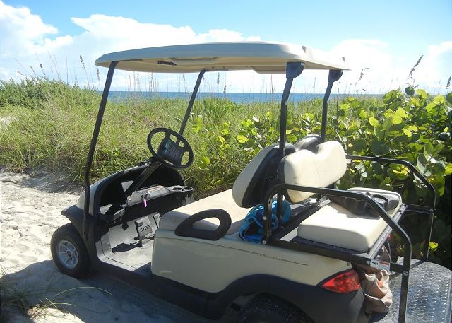 Golf cart included for easy beach access.