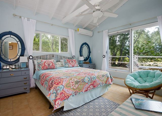 "Master bedroom 1 - ""Star"" themed with papasan chair overlooking emerald sea"