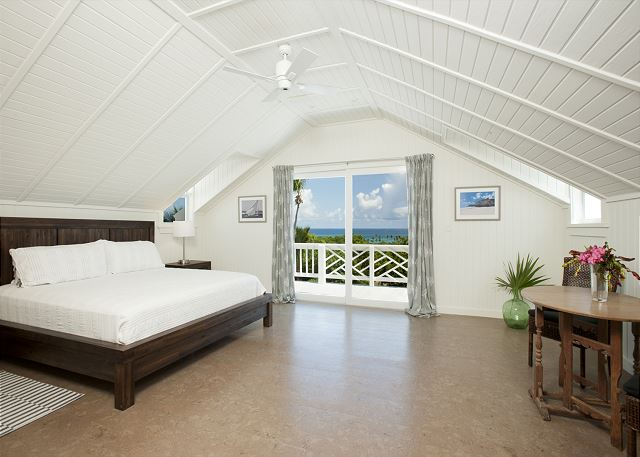 Master bedroom suite with king bed and ocean view.