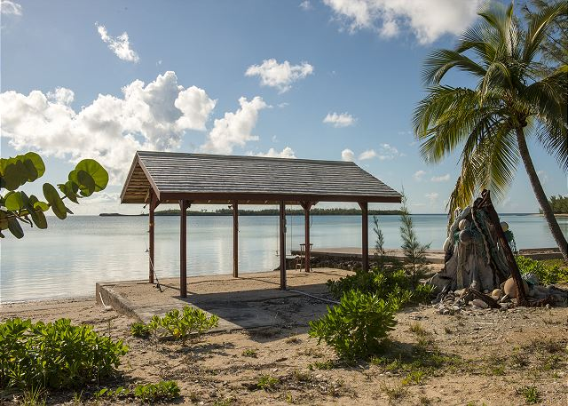 A small private beach, a hammock, and a gazebo with a swing.