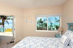 Bedroom 2, ocean view with patio access