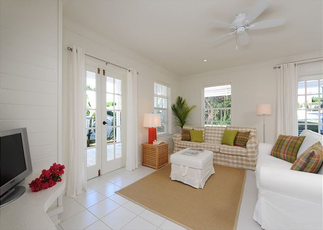 Living room with french doors leading to relaxing patio