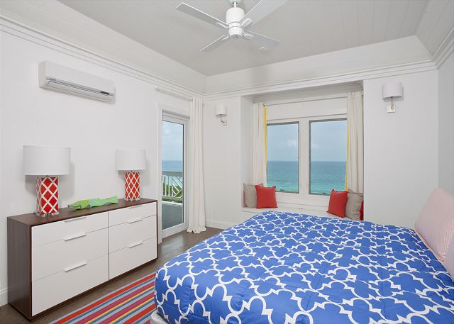 Master suite with balcony and 50-mile Caribbean view, facing the sunset.