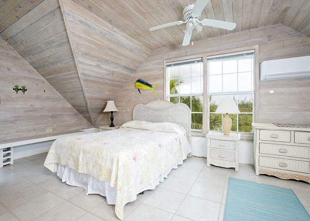 Master bedroom in Main Cottage, with beautiful ocean views