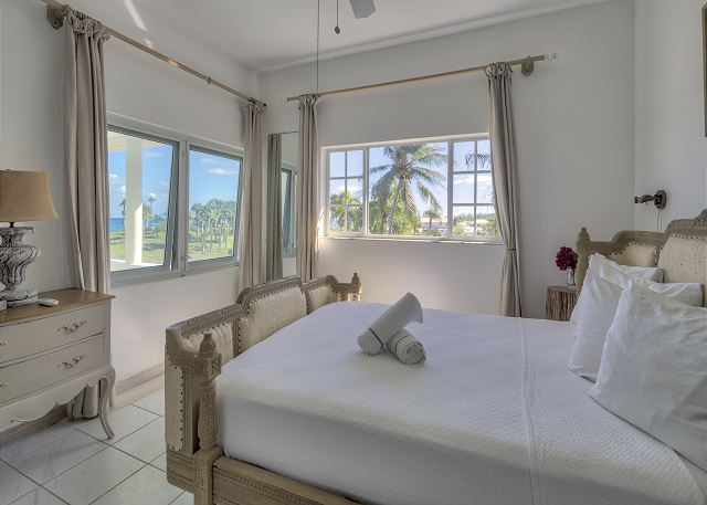 Bedroom suite 1 with king bed and ocean view