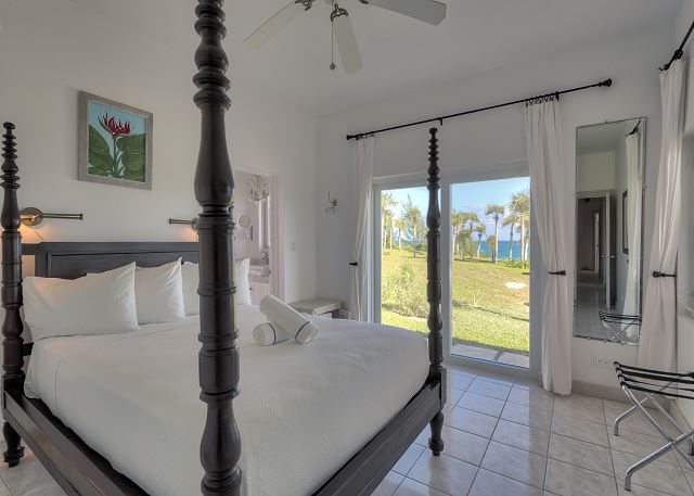 Bedroom Suite 2 with king bed and ocean view.