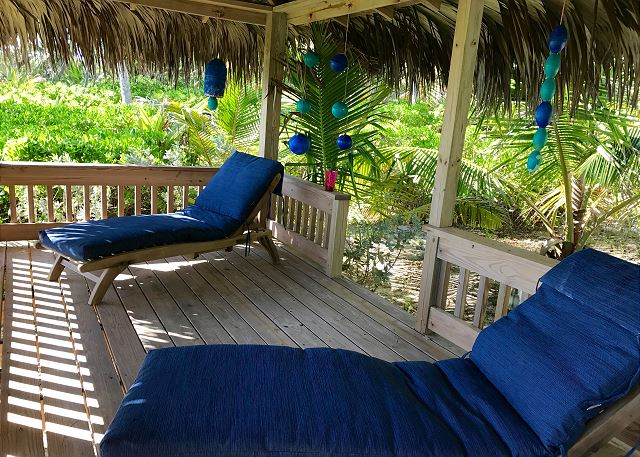 Cabana down by the beach with lounge seating