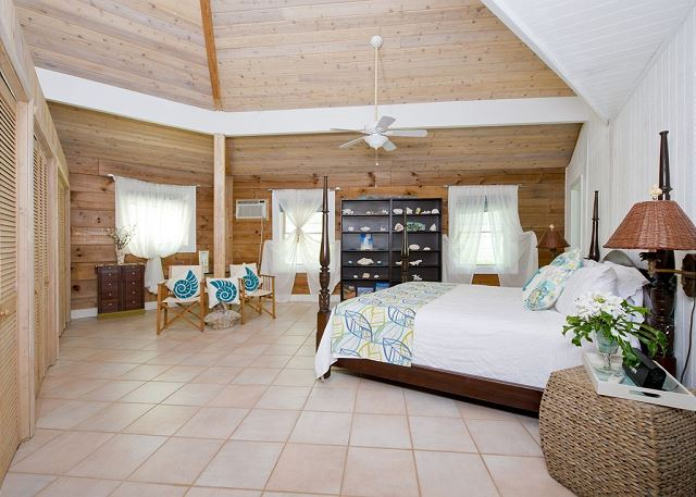 Master Suite with Soaring Ceiling, A/C, & En-suite Washroom