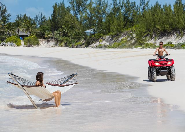 Relaxing on Ananda's beach. (Four-wheeler available for daily rental.)