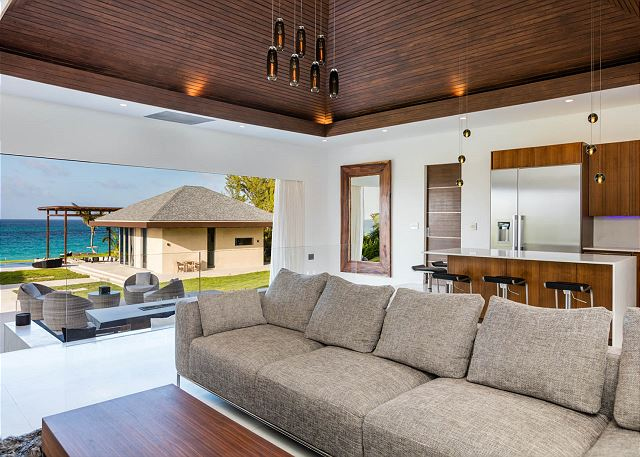 Open concept living area with retractable wall and magnificent ocean views.