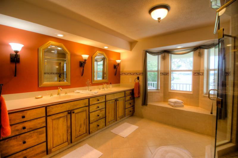 Large Master Bathroom with Exquisite Cabinetry.