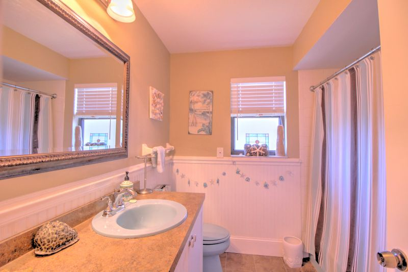 Upstairs shared bathroom with tub and shower