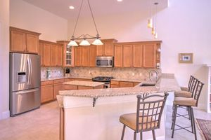 Fully equipped granite kitchen with gas stove