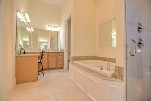 Large master bath with walk in shower and powder room