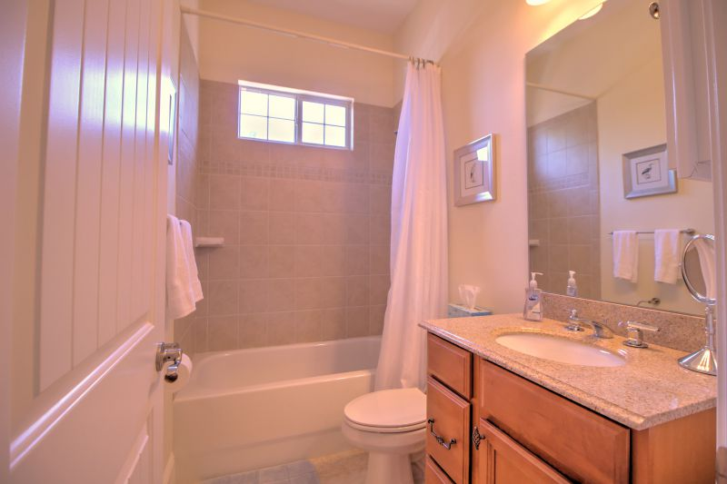 Second master retreat bathroom with shower and tub