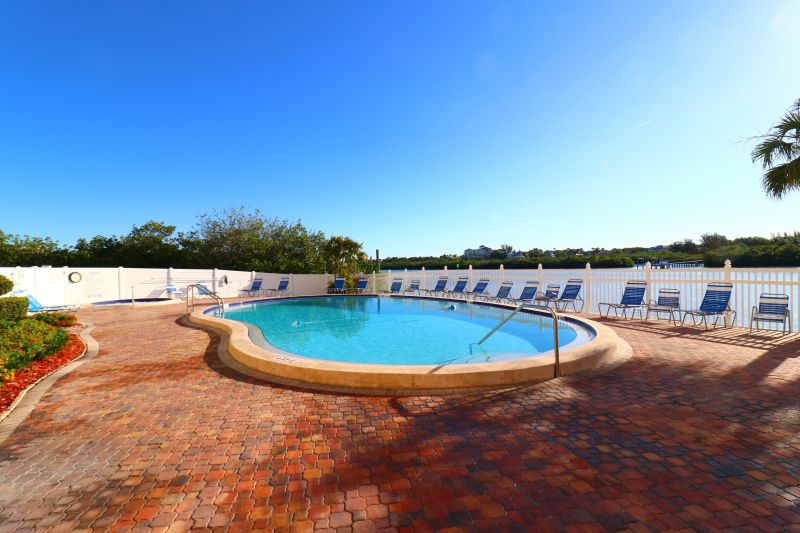 You own expansive pool and hot tub facility with barbecue
