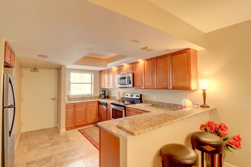Granite Kitchen with hardwood cabinets, fully stocked